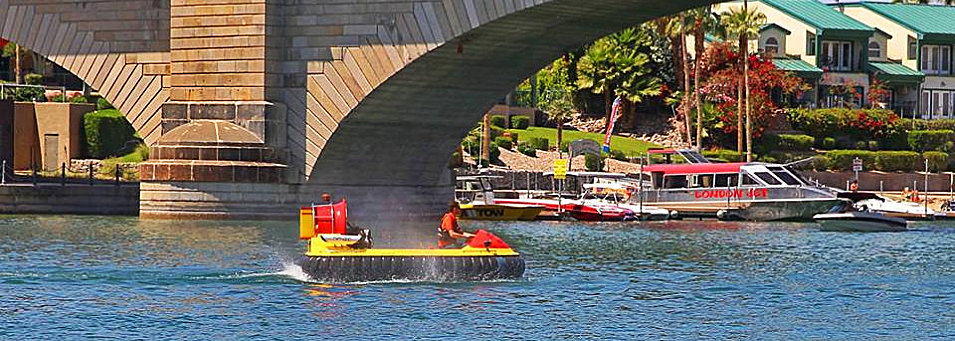3 person hovercraft fly under the bridge